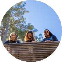 Students on a bridge, redwood trees in background